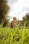 Boy in field with camera Stock Photo - Premium Royalty-Free, Artist: CulturaRM, Code: 6114-06600779