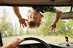 Boy upside down on car windscreen Stock Photo - Premium Royalty-Free, Artist: Ascent Xmedia, Code: 6114-06600781