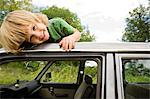 Boy on roof of car Stock Photo - Premium Royalty-Free, Artist: CulturaRM, Code: 6114-06600782