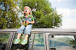 Boy with binoculars, sitting on roof of car Stock Photo - Premium Royalty-Free, Artist: CulturaRM, Code: 6114-06600783