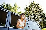 Girl blowing bubbles from car Stock Photo - Premium Royalty-Free, Artist: Aflo Relax, Code: 6114-06600800