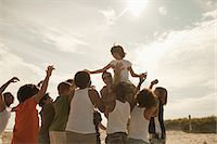 Boy being carried on shoulders Stock Photo - Premium Royalty-Freenull, Code: 6114-06600804
