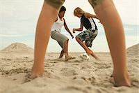 Boys playing football on beach Stock Photo - Premium Royalty-Freenull, Code: 6114-06600845