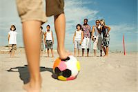Boys playing football on beach Stock Photo - Premium Royalty-Freenull, Code: 6114-06600849