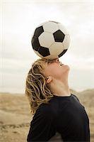 Boy balancing football on head Stock Photo - Premium Royalty-Freenull, Code: 6114-06600868