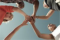 Boys doing huddle, low angle view Stock Photo - Premium Royalty-Freenull, Code: 6114-06600893