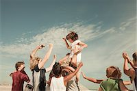 Boy being carried on shoulders Stock Photo - Premium Royalty-Freenull, Code: 6114-06600895