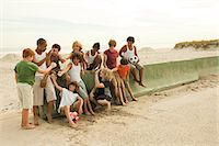 preteen beach - Group of boys by wall with football Stock Photo - Premium Royalty-Freenull, Code: 6114-06600897