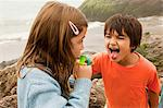 Children with lollipop, boy sticking out tongue Stock Photo - Premium Royalty-Free, Artist: Mitch Tobias, Code: 6114-06600932