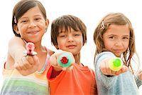 Children holding lollipops Stock Photo - Premium Royalty-Freenull, Code: 6114-06600933