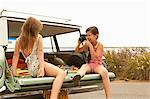 Two girls sitting in estate car taking photograph Stock Photo - Premium Royalty-Free, Artist: Robert Harding Images, Code: 6114-06600947