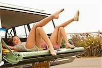 Two girls lying in estate car with legs in the air Stock Photo - Premium Royalty-Freenull, Code: 6114-06600948