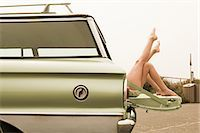 Two girls lying in estate car with legs in the air Stock Photo - Premium Royalty-Freenull, Code: 6114-06600950