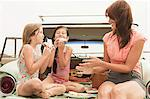 Mother and daughters eating sandwiches on car boot Stock Photo - Premium Royalty-Free, Artist: Aflo Relax, Code: 6114-06600960