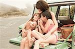 Mother and daughters eating sandwiches on car boot Stock Photo - Premium Royalty-Free, Artist: Aflo Relax, Code: 6114-06600965