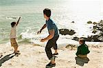Father and two children throwing stones into sea Stock Photo - Premium Royalty-Free, Artist: Robert Harding Images, Code: 6114-06600995