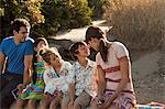 Family sitting on vacation Stock Photo - Premium Royalty-Free, Artist: Blend Images, Code: 6114-06600996