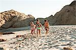Children running on beach Stock Photo - Premium Royalty-Free, Artist: Robert Harding Images, Code: 6114-06601013