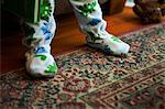 Baby boy standing on rug Stock Photo - Premium Royalty-Freenull, Code: 6114-06601036