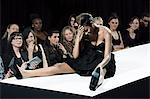 Model sitting on catwalk having fallen down at fashion show Stock Photo - Premium Royalty-Free, Artist: CulturaRM, Code: 6114-06601111