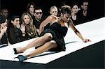 Model sitting on catwalk having fallen down at fashion show Stock Photo - Premium Royalty-Free, Artist: CulturaRM, Code: 6114-06601126