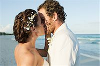 Bride and groom kissing on beach Stock Photo - Premium Royalty-Freenull, Code: 6114-06601192