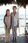Mid adult couple on vacation in beach hut Stock Photo - Premium Royalty-Free, Artist: Blend Images, Code: 6114-06601222