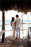 Mid adult couple on vacation in beach hut Stock Photo - Premium Royalty-Free, Artist: Westend61, Code: 6114-06601230