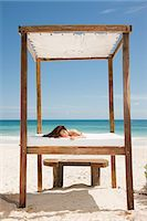 paradise (place of bliss) - Woman lying on bed on sandy beach Stock Photo - Premium Royalty-Freenull, Code: 6114-06601305