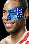 Man with US flag painted on face and shoulder Stock Photo - Premium Royalty-Freenull, Code: 6114-06601412