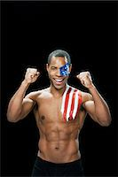 shirtless men - Man with US flag painted on face and shoulder cheering Stock Photo - Premium Royalty-Freenull, Code: 6114-06601416