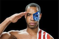 shirtless men - Man with US flag painted on face and shoulder saluting Stock Photo - Premium Royalty-Freenull, Code: 6114-06601420