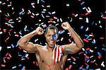 Man with US flag painted on face and shoulder with ticker tape Stock Photo - Premium Royalty-Free, Artist: Robert Harding Images, Code: 6114-06601421