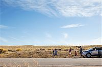 remote car - Family with car on desert road Stock Photo - Premium Royalty-Freenull, Code: 6114-06601594