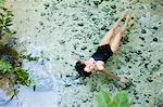 Young woman floating in lagoon, Grande Cenote, Quintana Roo, Tulum, Mexico Stock Photo - Premium Royalty-Free, Artist: Cultura RM, Code: 6114-06601658