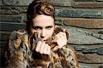Young woman wearing fur coat, portrait Stock Photo - Premium Royalty-Free, Artist: Mick Ritzel, Code: 6114-06601751