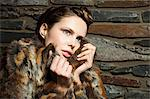 Young woman wearing fur coat, portrait Stock Photo - Premium Royalty-Free, Artist: ableimages, Code: 6114-06601752