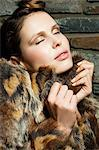 Young woman wearing fur coat, portrait Stock Photo - Premium Royalty-Free, Artist: Westend61, Code: 6114-06601754