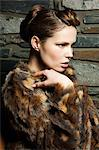 Young woman wearing fur coat, portrait Stock Photo - Premium Royalty-Free, Artist: Blend Images, Code: 6114-06601755