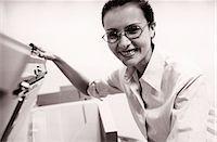 Woman at photocopier Stock Photo - Premium Royalty-Freenull, Code: 6114-06601932