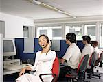 Call centre workers Stock Photo - Premium Royalty-Free, Artist: Blend Images, Code: 6114-06602194