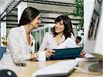 Women discussing report Stock Photo - Premium Royalty-Free, Artist: Uwe Umstätter, Code: 6114-06602266