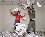 Two people playfighting with newspaper Stock Photo - Premium Royalty-Freenull, Code: 6114-06602378