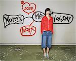 Woman standing by graffiti Stock Photo - Premium Royalty-Free, Artist: Blend Images, Code: 6114-06602400