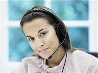 switchboard operator - Woman wearing telephone headset Stock Photo - Premium Royalty-Freenull, Code: 6114-06602486