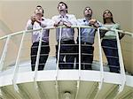 Colleagues looking up Stock Photo - Premium Royalty-Free, Artist: CulturaRM, Code: 6114-06602494