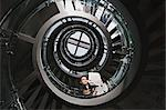 Businessman with newspaper on spiral staircase Stock Photo - Premium Royalty-Free, Artist: Aflo Relax, Code: 6114-06602588