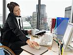 Woman at desk on telephone Stock Photo - Premium Royalty-Free, Artist: Zoran Milich, Code: 6114-06602636