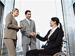 Office workers shaking hands Stock Photo - Premium Royalty-Free, Artist: Ikon Images, Code: 6114-06602643