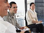 Three office workers in meeting Stock Photo - Premium Royalty-Free, Artist: CulturaRM, Code: 6114-06602649